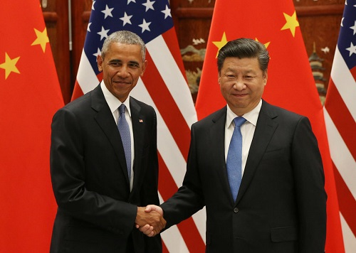 President Barack Obama and Chinese President Xi Jinping shake hands