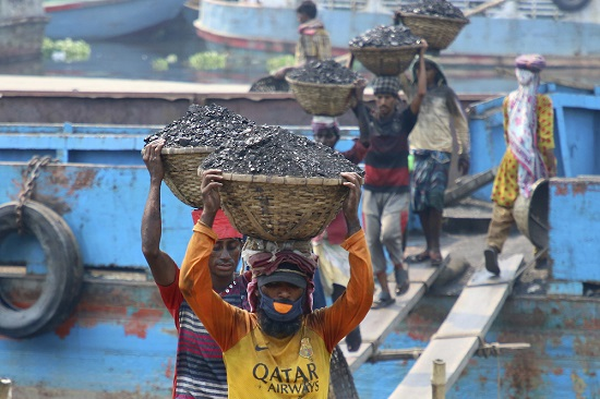 Unloading coal in Bangladesh