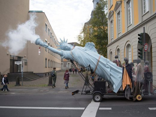 COP 23 Protests Smoking Statue of Liberty