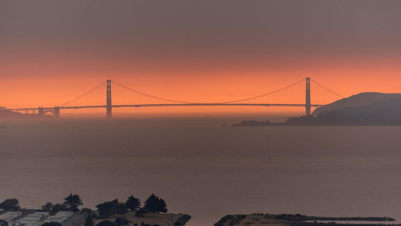 Smoke from wildfires creates an orange haze behind the Golden Gate Bridge in San Francisco.