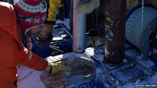 Photo of Greenland researchers drilling