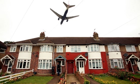 Jet over row houses in UK
